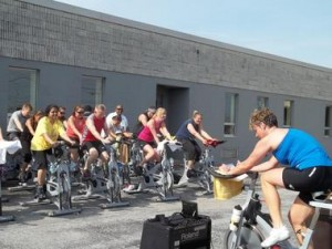 Putting the cycling excersize class on a flatbed blaring music added a new dangerous 'spin' to the activity.