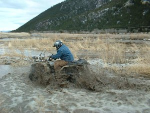 atv splashing in mud