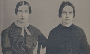 This is Emily Dickinson in an early selfie with one of her friends. Her friend doesn't look happy at all probably because she is cold with a formal feeling.