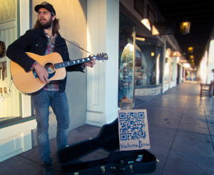 "What separates this musician from a homeless man is a QR code and his ability to play some ""wicked tunes""."